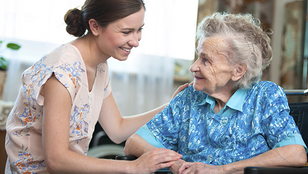 Image of older lady getting help in her home