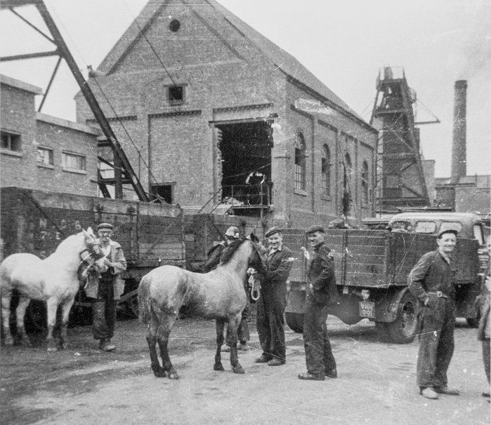 Workers with horses stood next to Snibston Colliery