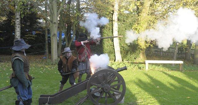 actors firing a cannon