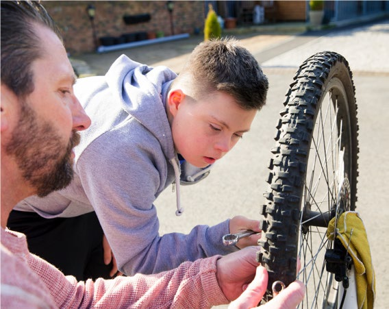 Young person fixing bike
