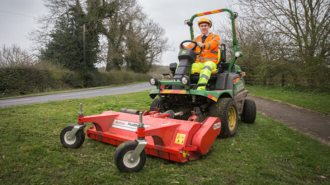 Person sitting on ride-on mower