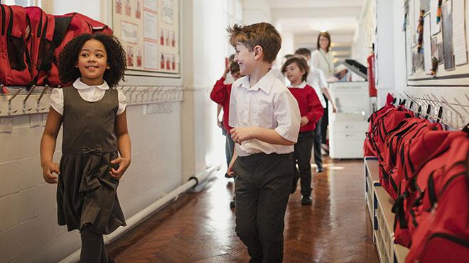 Schoolchildren in classroom corridor