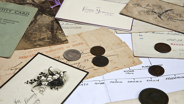 Scattered old documents and a family tree