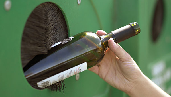 A glass bottle being recycled