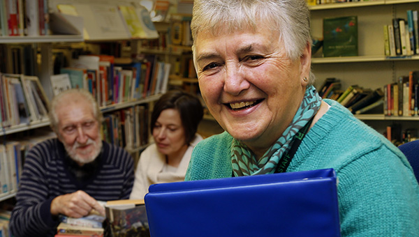 A volunteer helping at her library