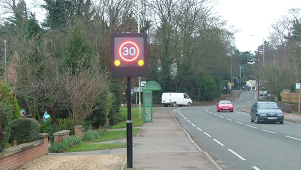 A flashing speed limit sign