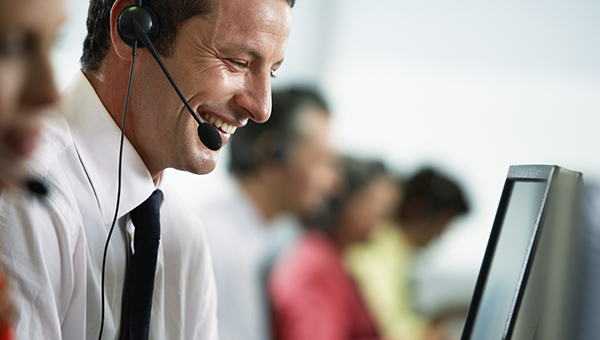 man wearing a headset in a call centre