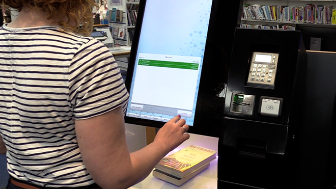 person using library computer