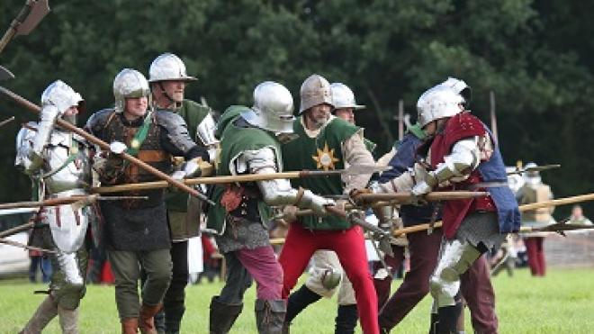 A group of people re-acting a battle at the Bosworth Medieval festival