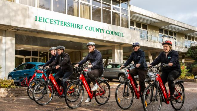 group of poeple cycling on electric bikes