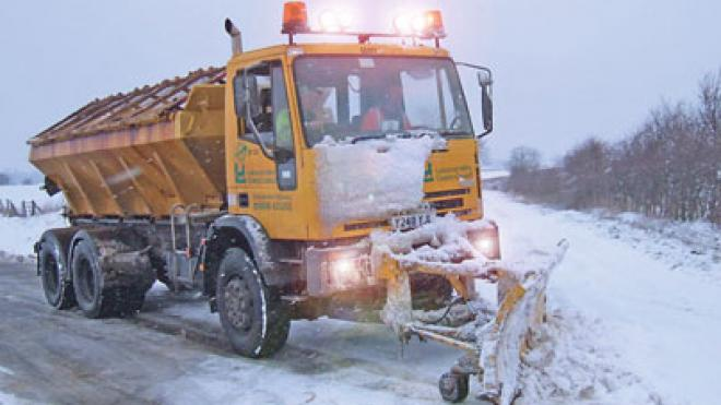 Gritter in snow with snow plough