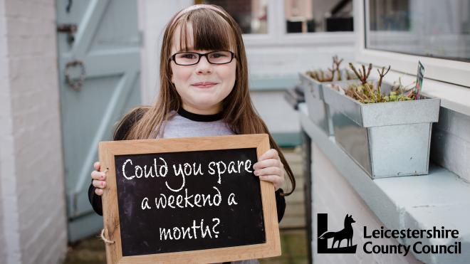 girl with chalk board with the message could you spare a weekend