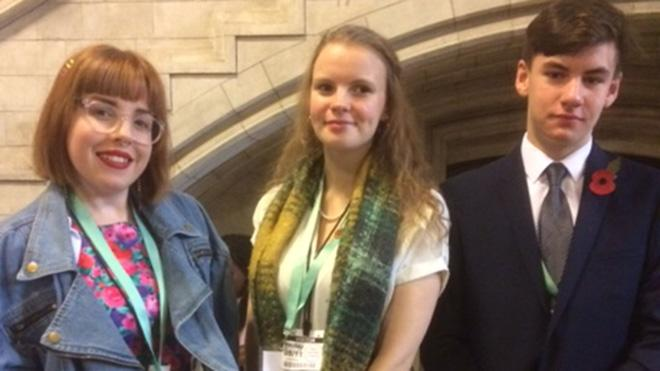 Three young people at Parliament