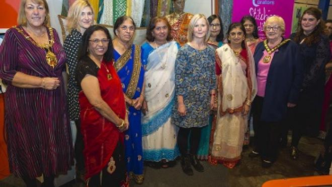 Members of the Anand Mangal ladies group dressed in colourful textiles