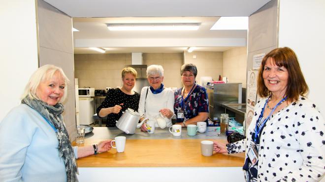 Volunteers in new Hospice Hope café making cups of tea