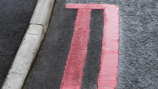 Red lines painted on a road