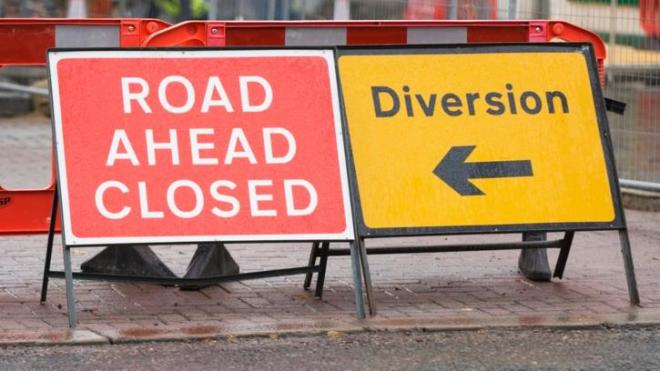Signs showing road closure and diversion