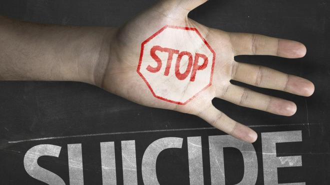 Hand illustrating stop suicide pledge