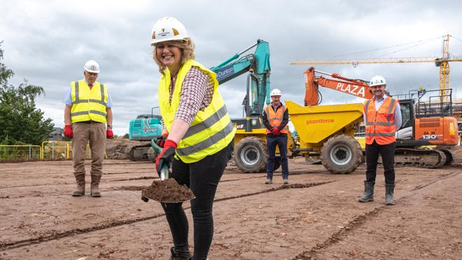Representatives from Leicestershire County Council and Willmott Dixon on the site where a new school is being built in Ashby