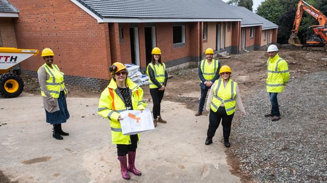 group of people social distanced on a building site