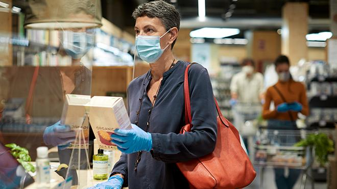 Woman wearing facemask in a shop