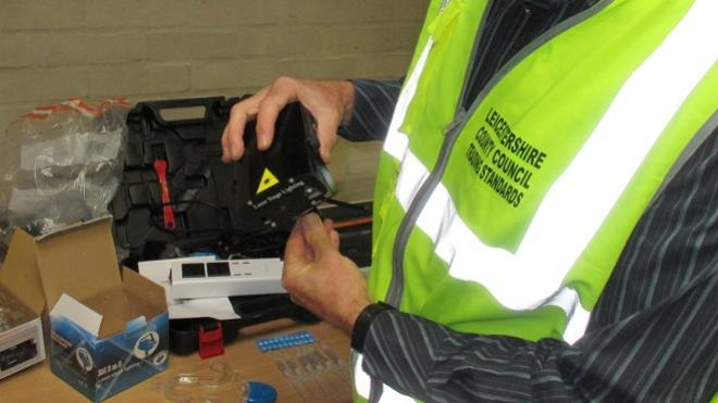 A Trading Standards Officer inspecting product safety