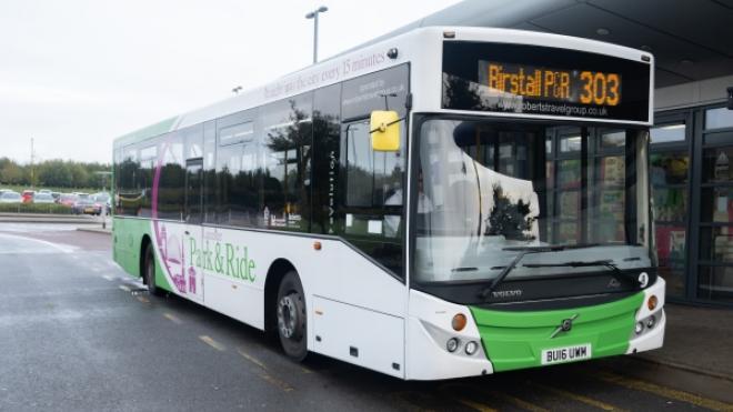 A bus picking up a passenger