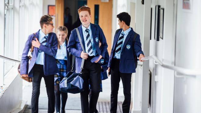 school children walk through school corridor