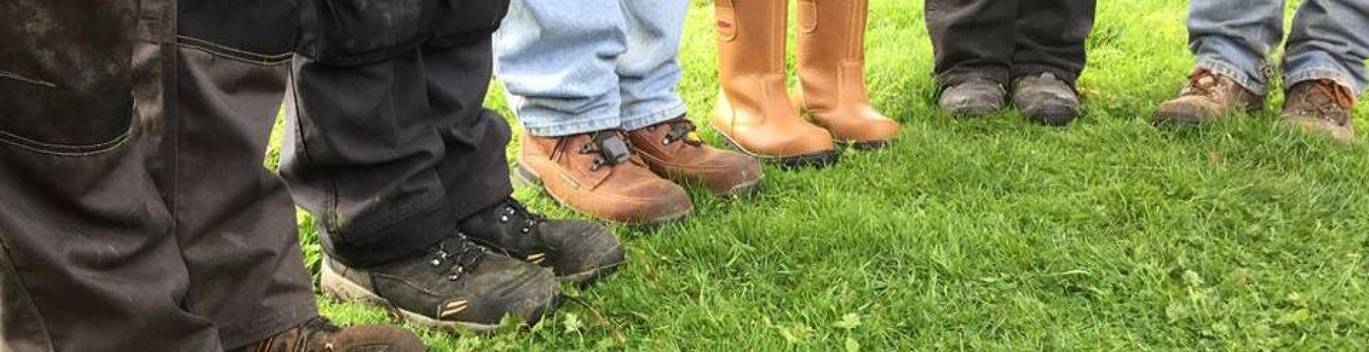 Muddy boots of conservation volunteers