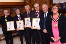 Four former councillors have been made honorary aldermen