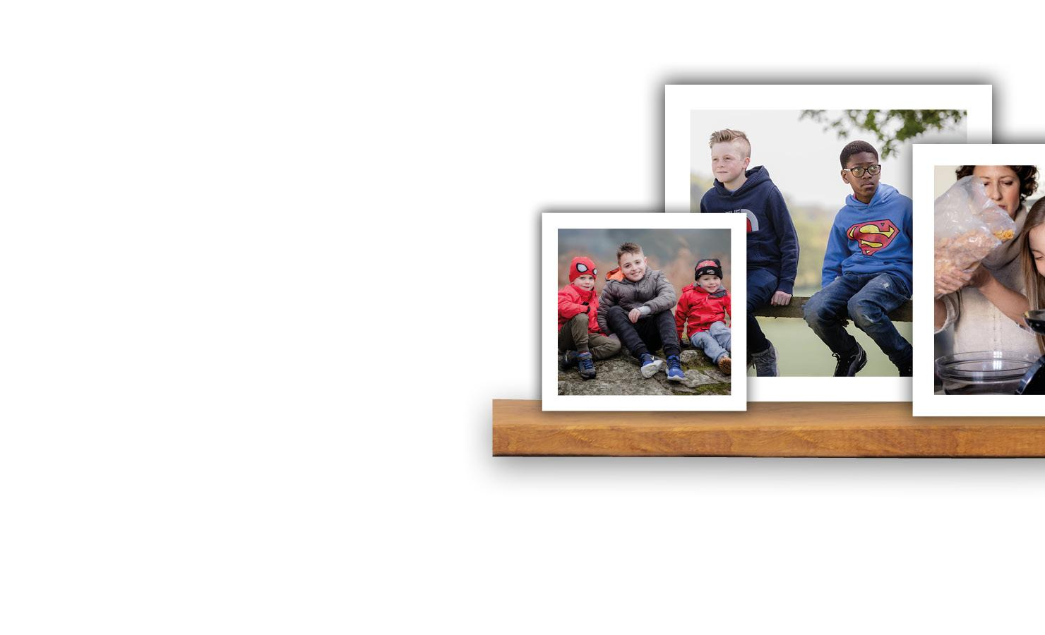 Photo frames on shelf showing different groups of children