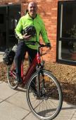 Man stands up on an electric bike