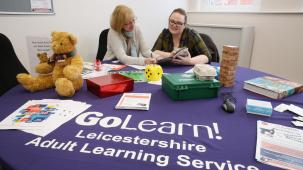 Two people going discussing the GoLearn courses on offer