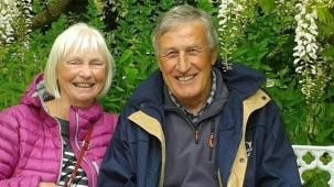 Man and woman sitting side by side smiling