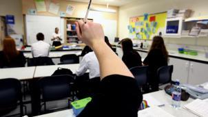 A teacher taking a lesson in a classroom