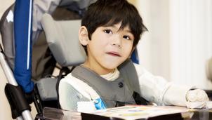 Boy sat in a wheelchair