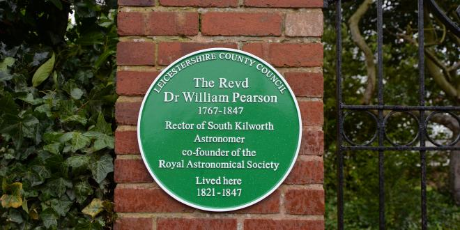 Green plaque on wall of former home of Revd Dr William Pearson