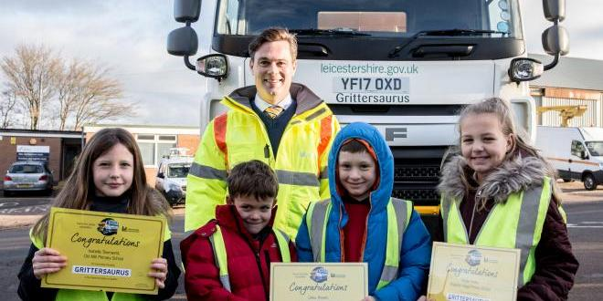 Schoolchildren recieve certificates after choosing winning entry in Name the Gritter competition