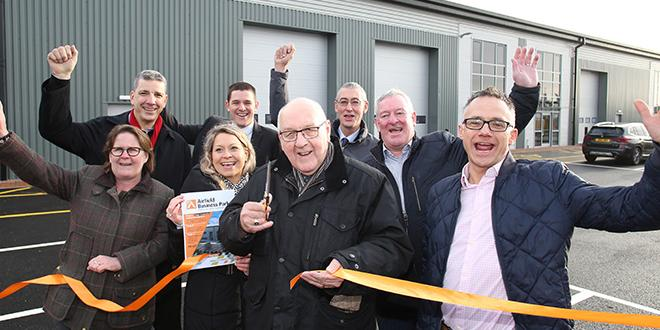 Proud members of Leicestershire county council cut the ribbon of the new business park