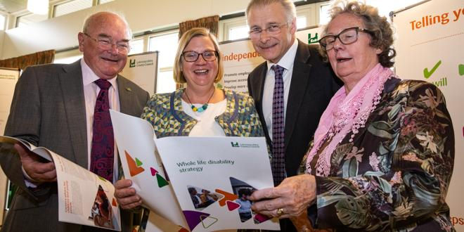Four people at the launch of the Whole Life Disability strategy