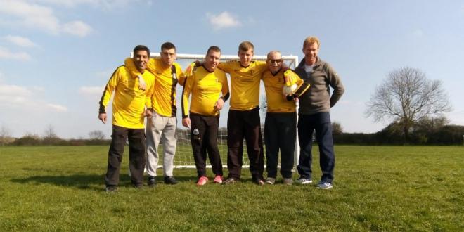 Team shot of an inclusive football team and their coach