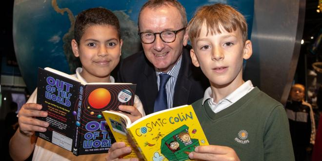 Two school children reading books