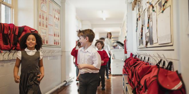 Schoolchildren in classroom corridors