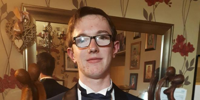 16 year old Tyler Hodgkinson wearing a dinner jacket and bow tie