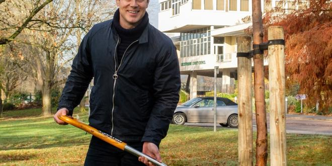 Councillor Blake Pain, cabinet member for the environment is pictured planting a tree outside County Hall.