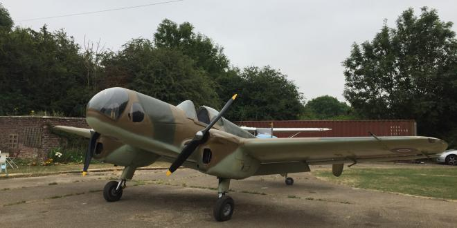 Vintage plane parked on field