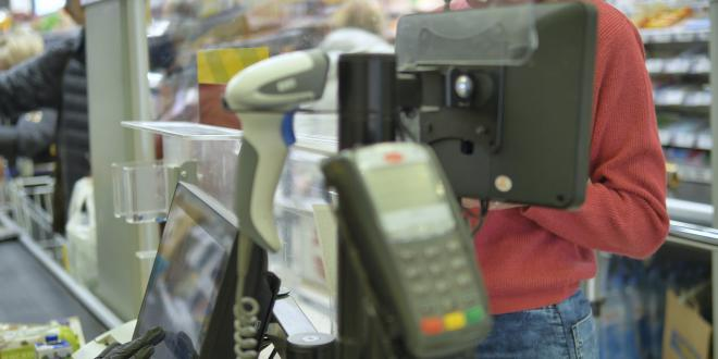 A person buying items in a retail shop